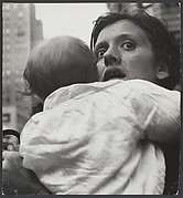 [Mother Holding Child, Herald Square, New York City]