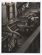 [Shoe Repair Service and Cigar Shop Seen from Elevated Train Platform, New York]