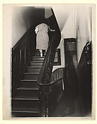 [Woman Ascending Stairs of Apartment Building, New York]