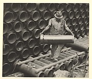 [Worker Carrying Large Water Pipe, New York]