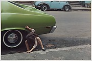 [Girl Playing Under Green Car, New York City]