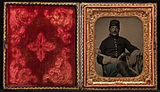[Union Cavalry Soldier, Seated, with Sword and Handgun]