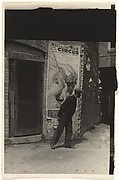 [Man in Front of Doorway of Liberty Cafe, with Walter L. Main Circus Poster on Wall]