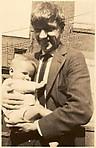 [Walker Evans Holding Anita Skolle, Child of Hanns and Lily Skolle, 13 East 14th Street,  New York City]