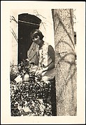 [Georgette Maury Standing in Garden with Potted Plant, Les Cyprés de St. Jean par Grasse, France]