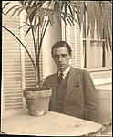 [Walker Evans Seated at Café Table with Potted Palm, Juan-les-Pins, France]
