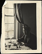 [Walker Evans Seated at Breakfast Table, Curtain Draped on Head, New York City]
