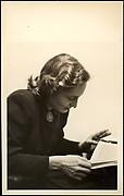 [Eleanor Clark, Reading and Holding Cigarette]