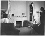 [Living Room Interior with Unidentified Man, Possibly Ben Schultz or Dan Weiner, 441 East 92nd Street, New York]