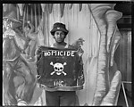 [Young Man Holding Jacket with Skull and Crossbones, Coney Island]