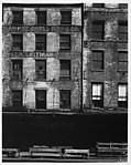 [Façade of Brick Buildings with Loading Dock Below]