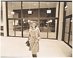 [Young Woman, Possibly Susan Thornton, Standing Before Glass Doors]