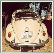 [Back of Volkswagen Beetle, England]