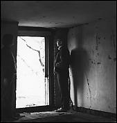 [Guy Davenport and Unidentified Woman in Darkened Room, Looking Through Doorway]
