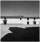 [Shadowed Plaza with Men in Doorway of Stone Building, Possibly Peru]