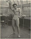 [Male Model Posed Pulling a Rope in Anna Huntington&#39;s Rooftop Studio]