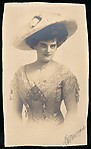 [Woman in Hat, Necklace, and Short Sleeved Gown]