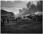[Battle Damage at Naval Air Station after Japanese Attack, Pearl Harbor, Dec. 7, 1941, Men Sweeping Debris from Runway]