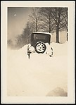 [Winter Scene of Automobile in Snowbank on Side of Road, Possibly Sandy Creek, New York]