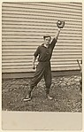[Man with Outstretched Arm in Front of House, Holding Baseball in Catcher's Mitt]