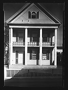 [Greek Revival House with Picket Fence and Iron Lyre Grillwork in Balcony]
