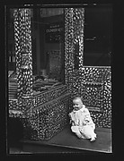 [Doll in Painted Doorway of Cutlery Shop, New York City]