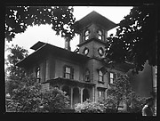 [Wooden Italianate Revival House with Simple Hipped Roof and Square Tower (and Man in Foreground), Roxbury or Dorchester, Massachusetts]