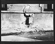 [Copy of Newspaper File Photograph: Bombed Wall, Probably Havana]