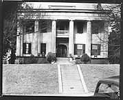 [Greek Revival House with Ornamental Friezework and Man Seated on Porch, Macon, Georgia]