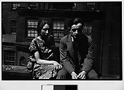 [Hanns and Lily Skolle Seated on Rooftop of 13 East 14th Street Apartment Building, New York City]