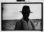 [Man Wearing Hat and Suspenders with Field in Background, Hale County?, Alabama]