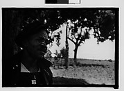 [Man Wearing Cap and Overalls with Field in Background, Hale County?, Alabama]