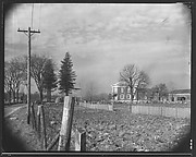 [Greek Revival House From Road with Fencepost in Foreground, Brewster, New York]