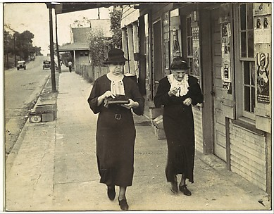 [Street Scene, Natchez, Mississippi: Two Women Walking along Sidewalk before Storefront]
