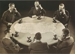[Advertisement for AT & T: Six Men on Telephones Sitting around a Table]