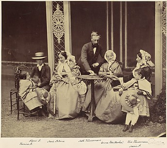 [Group Portrait of Five Adults and Two Children in a Garden]