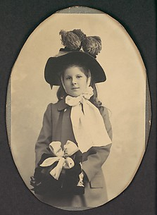 [Girl in Walking Costume with Hat and Muff]