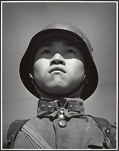 A fifteen-year-old stands at attention before his company leaves for the front and the decisive Sino-Japanese battles of the year. Hankow, March