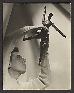[Paul Cadmus with Wooden Figure]