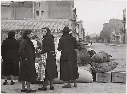 [Spanish Women in Street with Sacks and Boxes]
