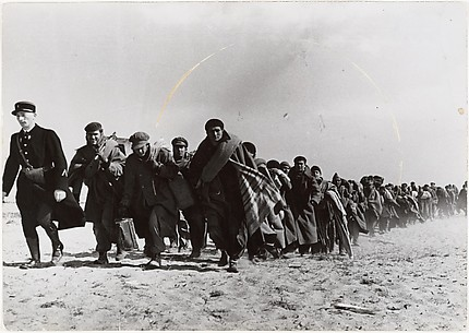 [Group of Refugees Marching on Dirt Road]