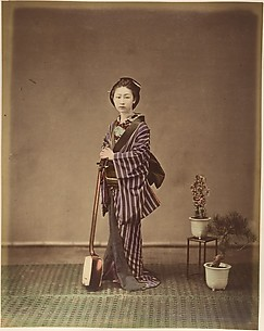 [Japanese Woman in Traditional Dress Posing with Instrument]