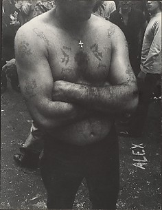 [Shirtless, Tattooed Man with Arms Folded, on Street, New York]