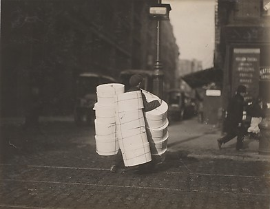 Boy carrying hats. Blee[c]ker St., N.Y.