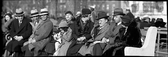 [People Sitting on Park Bench in the Bronx, New York City]