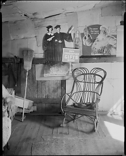 [Interior of Coal Miner's Home with Rocking Chair and Advertisements on Wall, West Virginia]