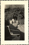 [Unidentified Man and Woman Seated on Lawn Chair]