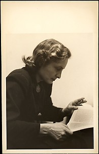 [Eleanor Clark, Reading and Holding Cigarette]