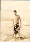 [South Seas: Walker Evans in Sarong on Beach]