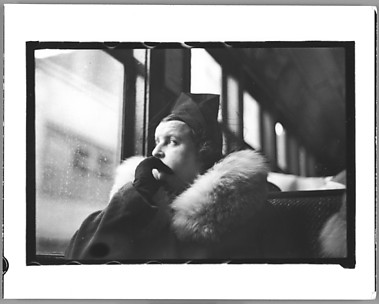 [Subway Passenger, New York City: Woman in Hat and Fur Collar Looking Out Window of Elevated Train]